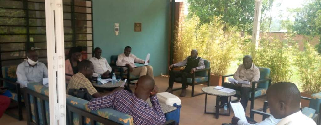District water and Sanitation coordination committee holding a quarterly meeting at IOWA State University Kamuli Campus.